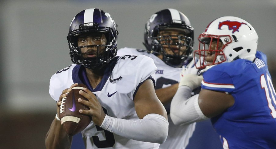 TCU Horned Frogs quarterback Shawn Robinson (3) scrambles for a touchdown in the third quarter against the Southern Methodist Mustangs at Gerald J. Ford Stadium.