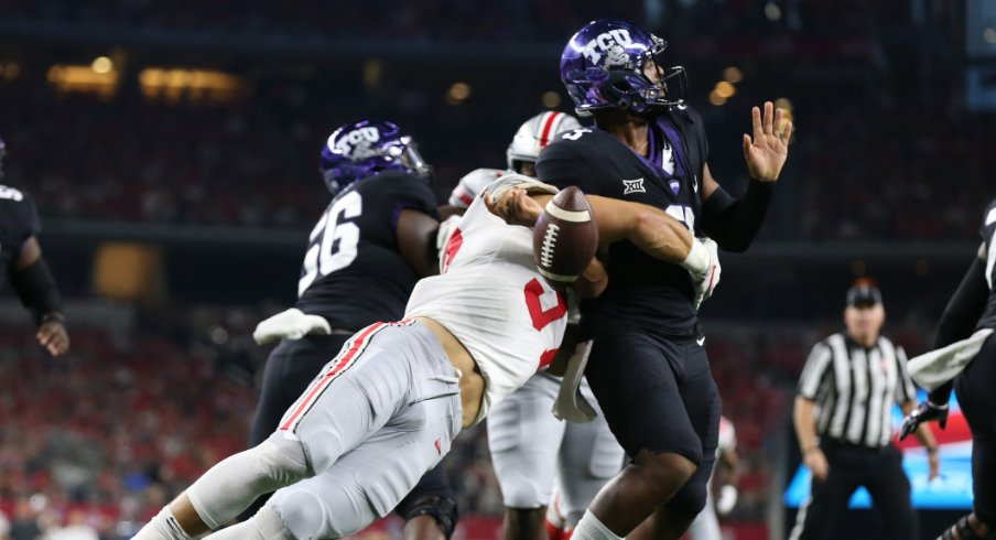 Texas Christian Horned Frogs quarterback Shawn Robinson (3) has the ball stripped by Ohio State Buckeyes defensive end Nick Bosa (97) at AT&T Stadium.