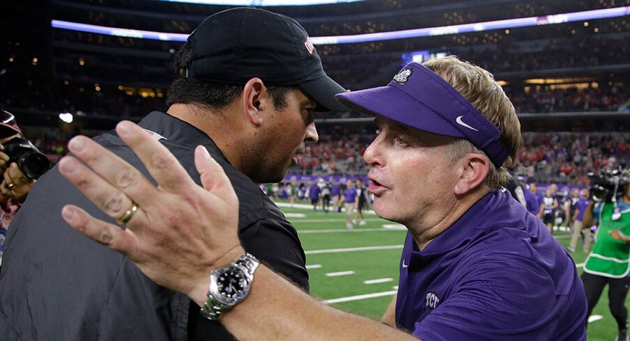 TCU coach Gary Patterson congratulates Ohio State coach Ryan Day following Ohio State's 40-28 win over the Horned Frogs.