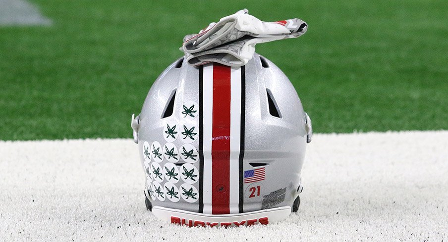 An Ohio State helmet sits on the field at AT&T Stadium.