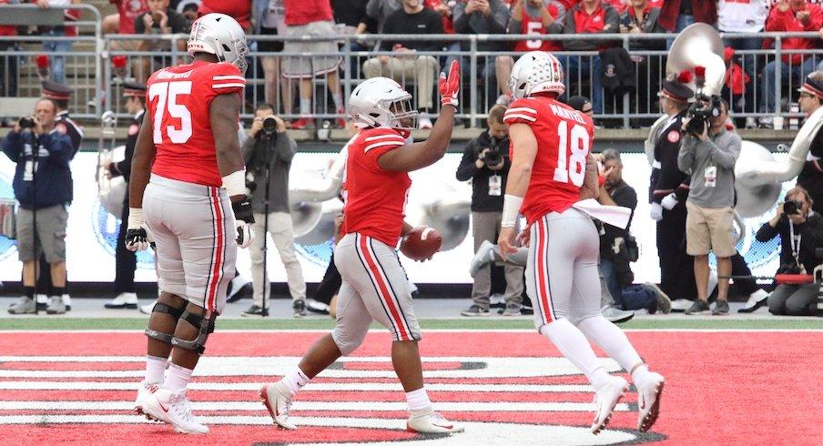 Thayer Munford, J.K. Dobbins and Tate Martell celebrate a Dobbins touchdown.
