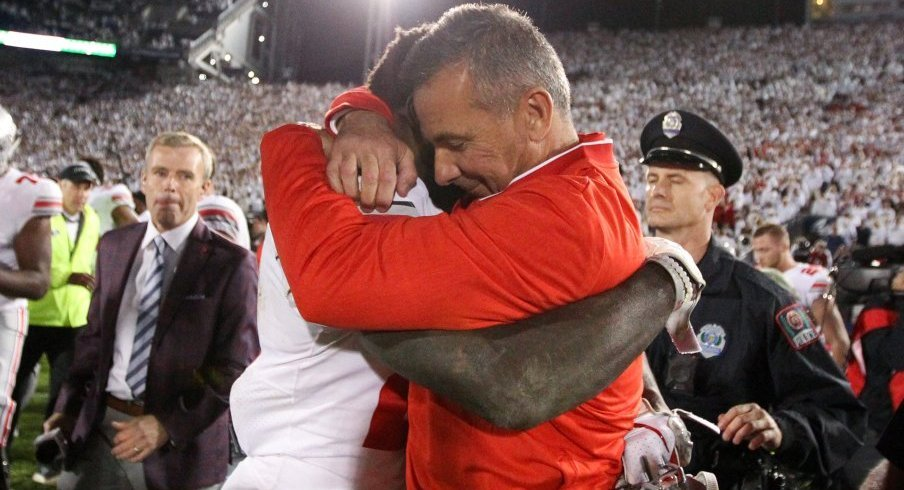 Urban Meyer hugs Parris Campbell following Ohio State's win in Happy Valley.