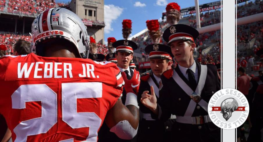 Mike Weber high fives the band.