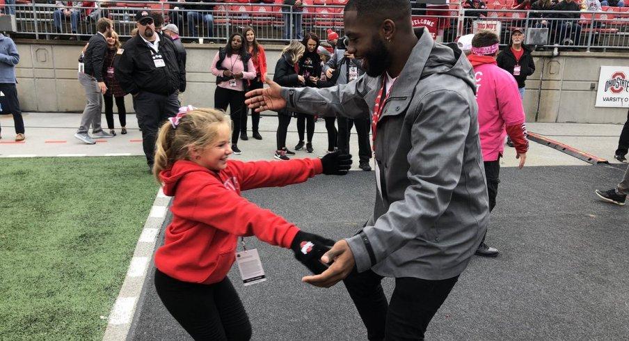 Ryan Day's daughter Grace hugs J.T. Barrett