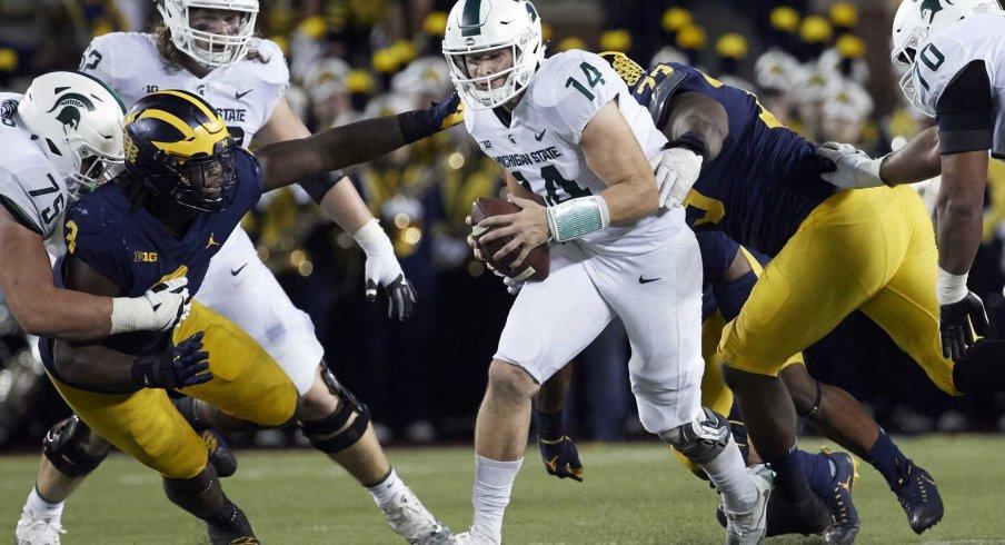 Brian Lewerke escapes the Michigan defensive line