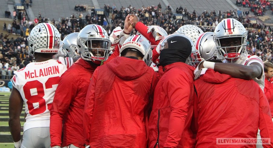 Ohio State wide receivers huddle before Saturday's game at Purdue.