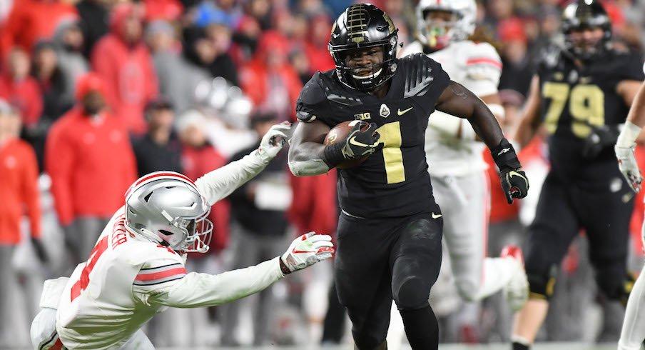 D.J. Knox runs past Ohio State's Jordan Fuller for a touchdown.