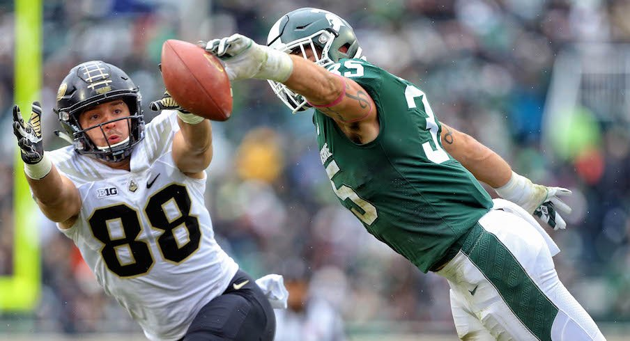 Michigan State's Joe Bachie breaks up a pass intended for Purdue's Cole Herdman.