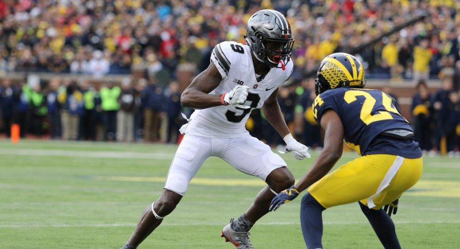 Ben Victor beats a Michigan-man off the line