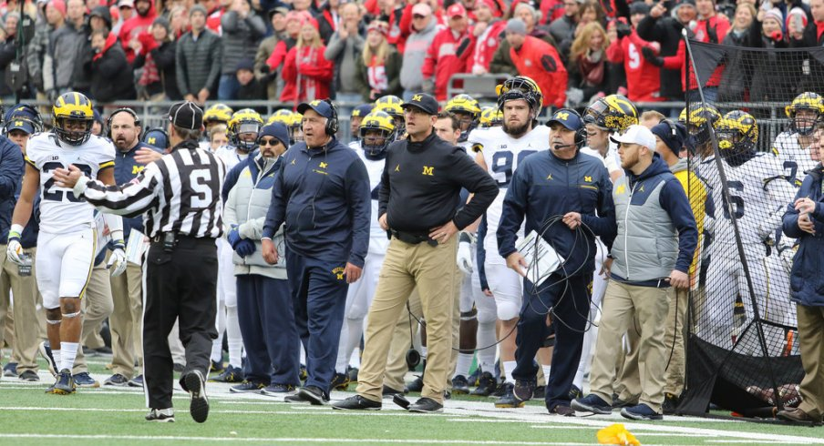 Jim Harbaugh watches in anguish as Ohio State drives down the field.