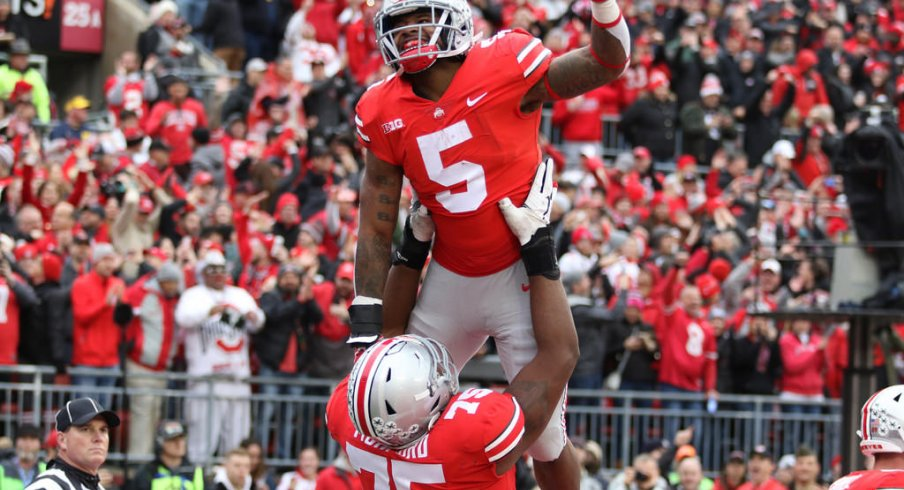 Mike Weber celebrates with Thayer Munford