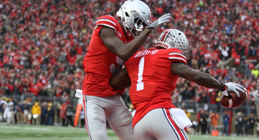 Victor and Dixon celebrate after a touchdown