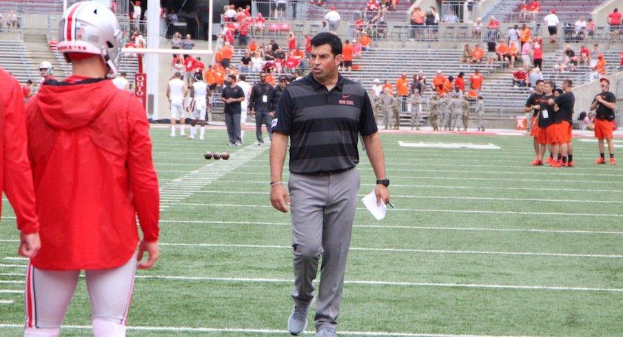 Ryan Day coaching quarterbacks during pregame warmups.