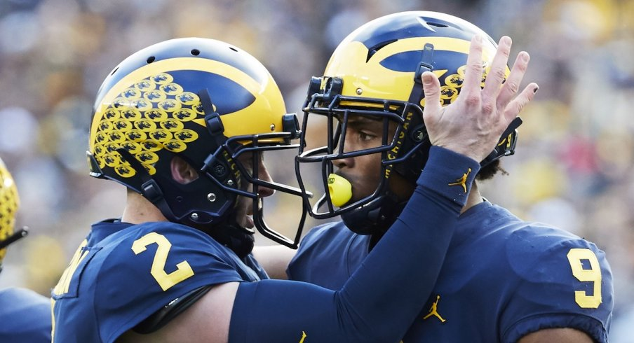 Nov 3, 2018; Ann Arbor, MI, USA; Michigan Wolverines wide receiver Donovan Peoples-Jones (9) receives congratulations from quarterback Shea Patterson (2) after he scores a touchdown in the first half against the Penn State Nittany Lions at Michigan Stadium. Mandatory Credit: Rick Osentoski-USA TODAY Sports