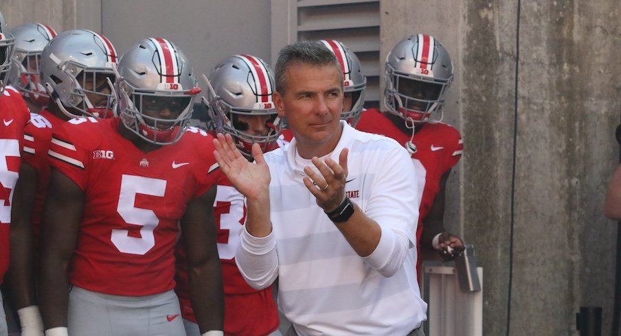 Urban Meyer and the Buckeyes before a game this season.