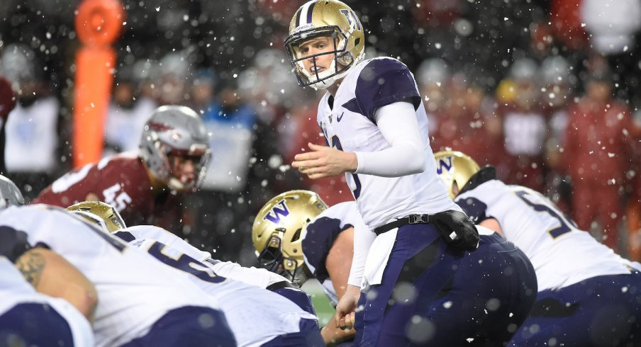 Jake Browning reads the defense before taking snap in the snow.