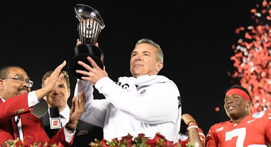 Urban Meyer hoists the Rose Bowl trophy after Ohio State defeated Washington in Pasadena.