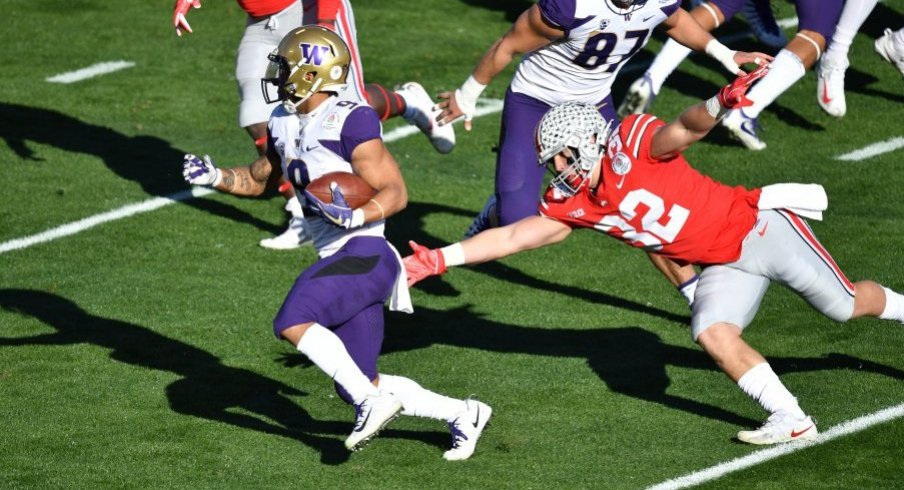 Myles Gaskin runs past Tuf Borland in the Rose Bowl.