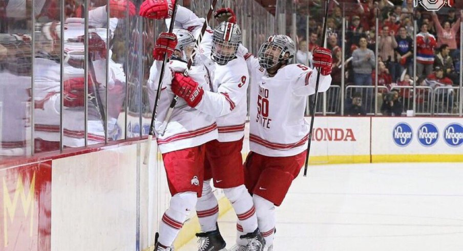 Tanner Laczynski and Matt Miller celebrate a goal in the Buckeyes' win over Michigan.