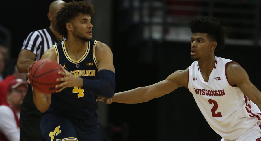 Wisconsin forward Aleem Ford defends Michigan's Isaiah Livers