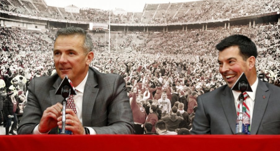 Nov 24, 2018; Columbus, OH, USA; Ohio State Buckeyes fans swarm the field after a victory over the Michigan Wolverines at Ohio Stadium. Mandatory Credit: Greg Bartram-USAT Sports | Dec 4, 2018; Columbus, OH, USA; Ohio State Buckeyes head coach Urban Meyer (left) addresses members of the media to announce his intentions to step down from coaching after the Rose Bowl game. Meyer is pictured with newly named head coach Ryan Day during the press conference at the OSU Fawcett Center. Joe Maiorana-USAT Sports