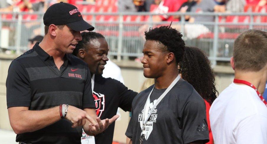 WR coach Brian Hartline talks to a recruit