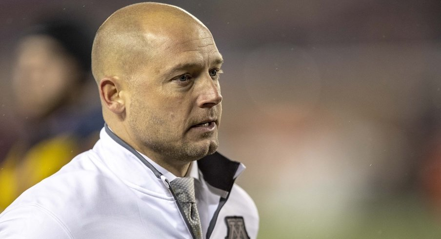 Jerry Kill and P.J. Fleck are not great pals.