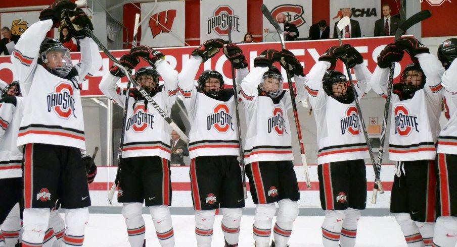 The women's hockey Buckeyes celebrate a home win.
