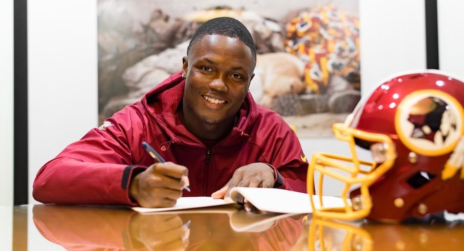 Terry McLaurin signs his NFL contract.