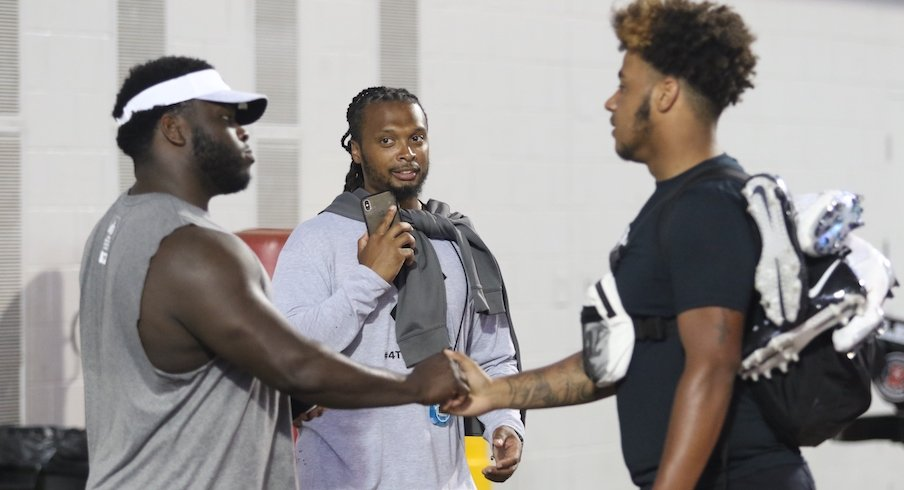 Brandon Collier (middle) and Tyrese Owusu-Bediako (right) meet Robert Landers at Thursday's Ohio State football camp.