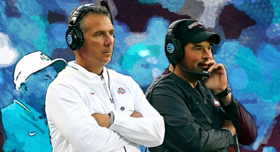 Sep 22, 2018; Columbus, OH, USA; Ohio State Buckeyes head coach Urban Meyer (center) watches the game from the sidelines with assistant coach Ryan Day (right) and assistant coach Tony Alford (left) during the third quarter against the Ohio State Buckeyes at Ohio Stadium. Mandatory Credit: Joe Maiorana-USA TODAY Sports