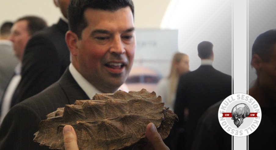 Ryan Day holds a reptilian creature in today's Skull Session.