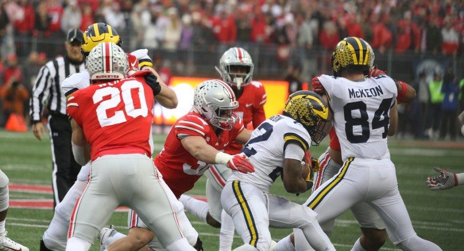 Borland takes down a Michigan ballcarrier.