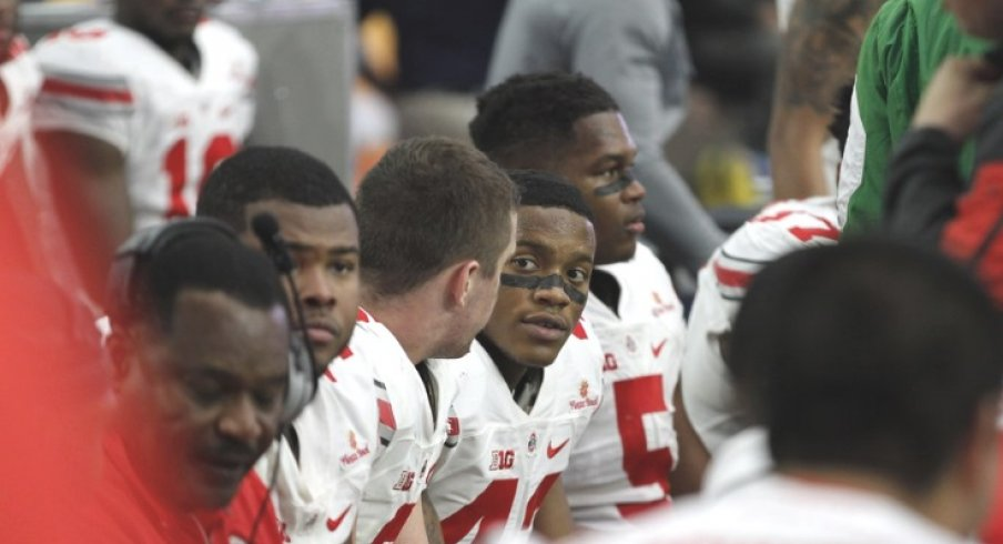 Buckeyes sitting on the bench.