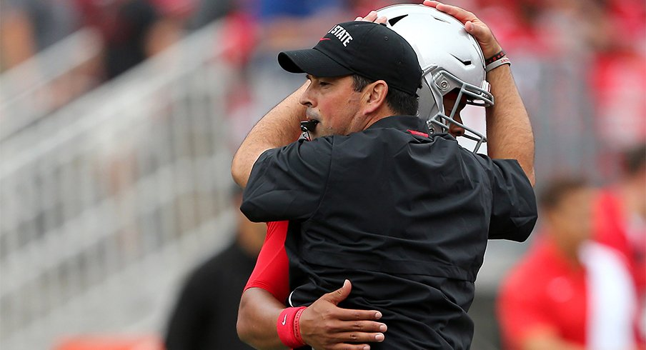 Ohio State head coach Ryan Day with quarterback Justin Fields