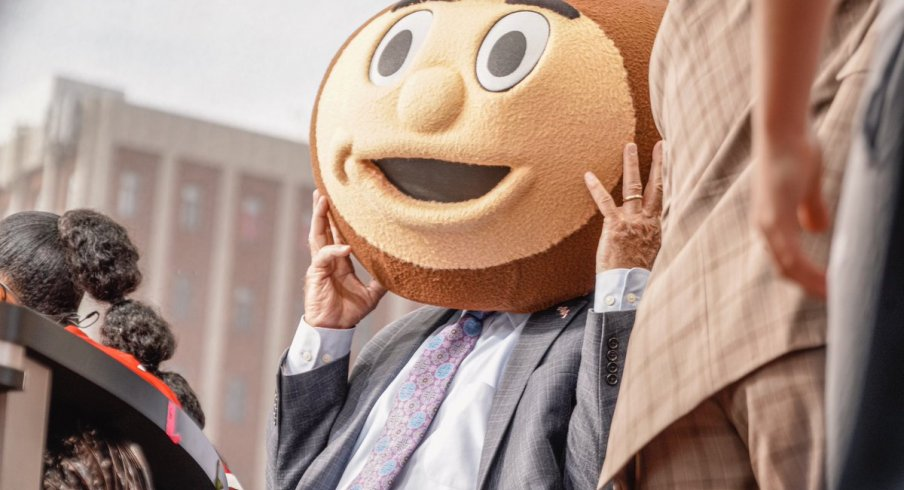 Corso wearing the Brutus headgear as he selects Ohio State in tonight's game.