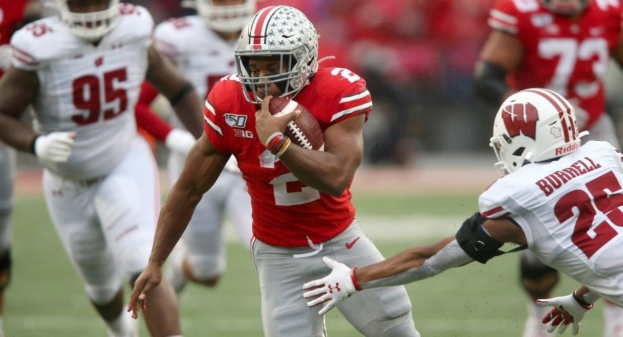 J.K. Dobbins tallied 221 total yards and two touchdowns in Ohio State's win over Wisconsin, dwarfing Jonathan Taylor's production.
