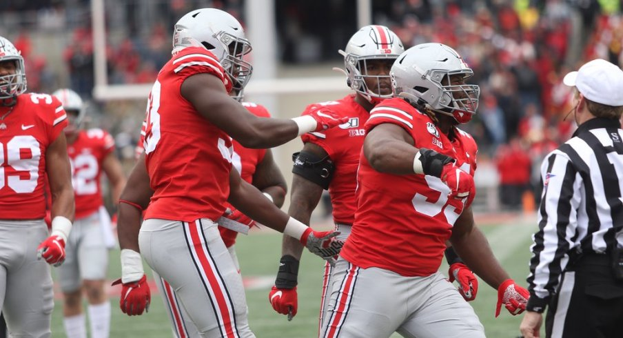 The defensive line celebrates a big play.