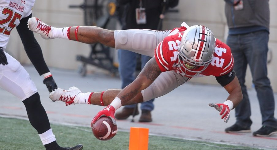 Ohio State's Marcus Crowley reaches for a touchdown against Maryland