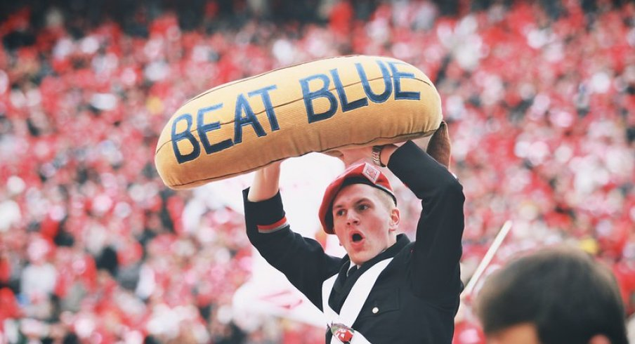 Band member holds the beat blue banana.
