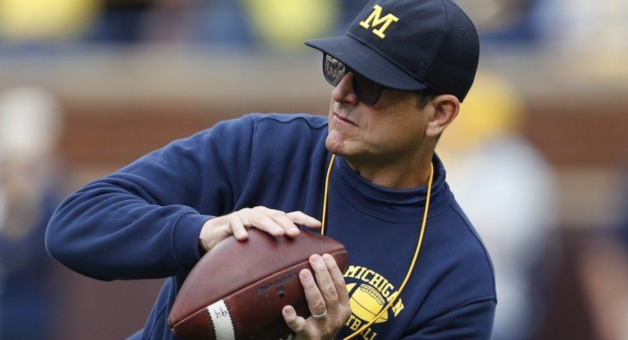 Sep 28, 2019; Ann Arbor, MI, USA; Michigan Wolverines head coach Jim Harbaugh catches a ball before the game against the Rutgers Scarlet Knights at Michigan Stadium. Mandatory Credit: Raj Mehta-USA TODAY Sports