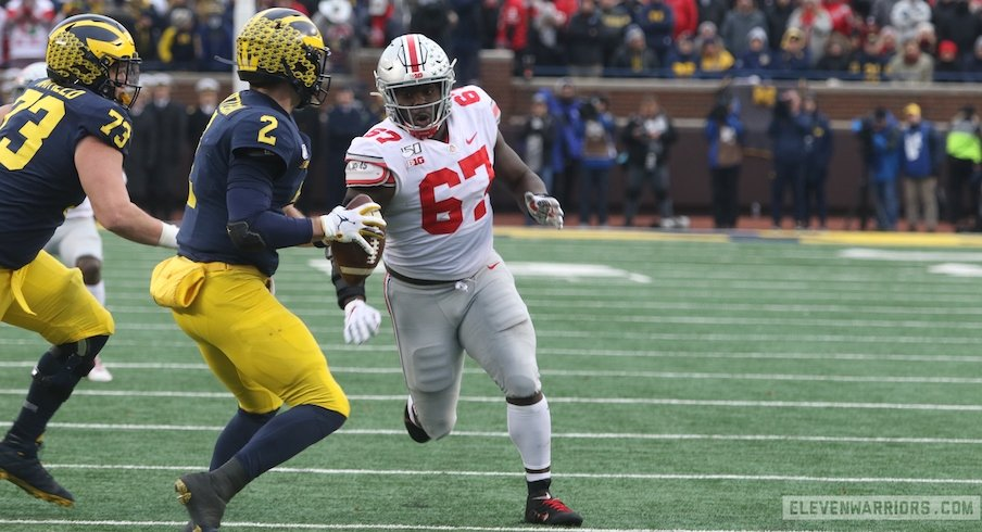Robert Landers chases Shea Patterson.