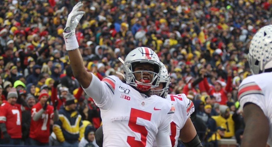 Garrett Wilson celebrates during Ohio State's 56-27 win over Michigan.