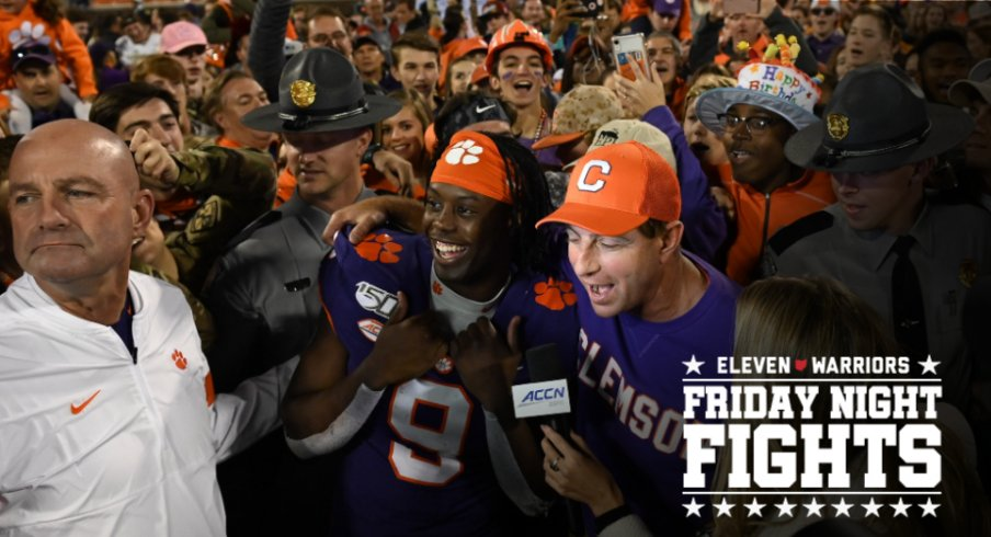 Nov 2, 2019; Clemson, SC, USA; Clemson Tigers head coach Dabo Swinney and running back Travis Etienne (9) talk with an ACC network reporter after defeating the Wofford Terriers at Clemson Memorial Stadium. Mandatory Credit: Adam Hagy-USA TODAY Sports