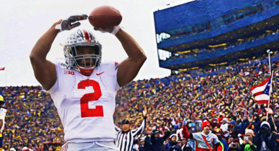 Nov 30, 2019; Ann Arbor, MI, USA; Ohio State Buckeyes running back J.K. Dobbins (2) celebrates after he scores a touchdown in the first half against the Michigan Wolverines at Michigan Stadium. Mandatory Credit: Rick Osentoski-USA TODAY Sports