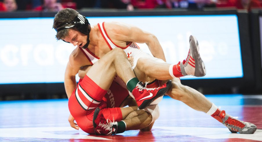 Nebraska's Alex Thomsen tangles up Ohio State's Malik Heinselman