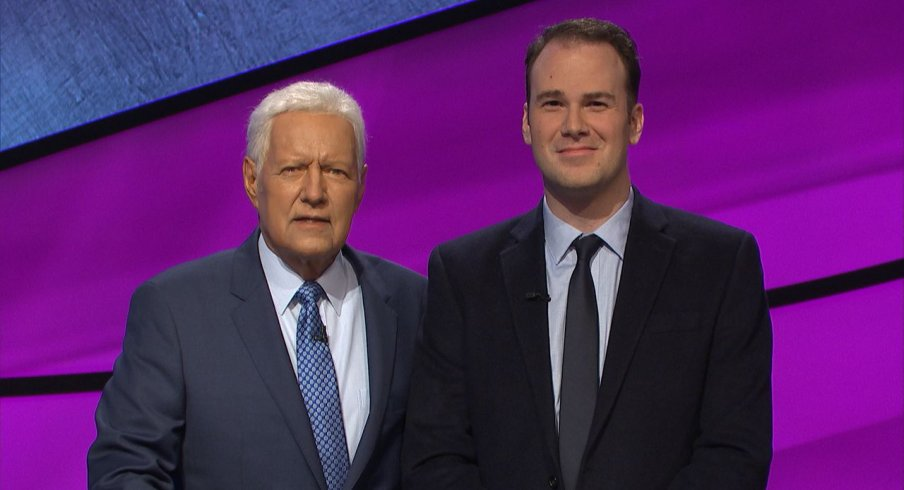"""""""Jeopardy"""" host Alex Trebek (left) poses with Aaron Goetsch (right) of Macomb, MI. Goetsch appeared as a contestant on the show on Thursday, Feb. 27. 2020. (Photo courtesy of Jeopardy Productions, Inc.)"""
