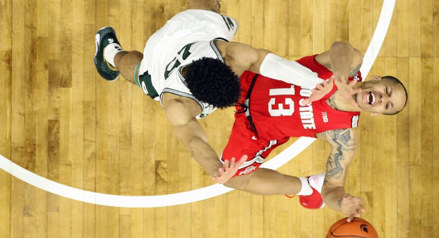 Mar 8, 2020; East Lansing, Michigan, USA; Ohio State Buckeyes guard CJ Walker (13) is defended by Michigan State Spartans forward Malik Hall (25) during the second half a game at the Breslin Center. Mandatory Credit: Mike Carter-USA TODAY Sports