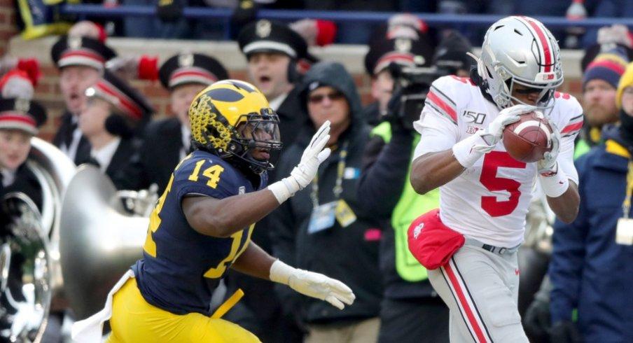Ohio State Buckeyes receiver Garrett Wilson catches a touchdown pass over Michigan Wolverines safety Josh Metellus during the second half at Michigan Stadium in Ann Arbor, Saturday, Nov. 30, 2019. Sad Michigan football
