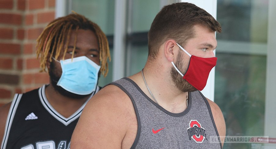 Wyatt Davis and Josh Myers exit the Woody Hayes Athletic Center after the Big Ten canceled fall football.